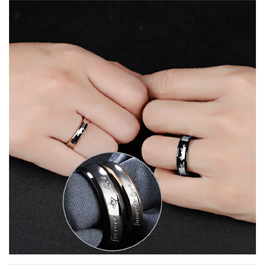 It is an image of Retro Style Stainless Steel Wedding Bands Couple Rings