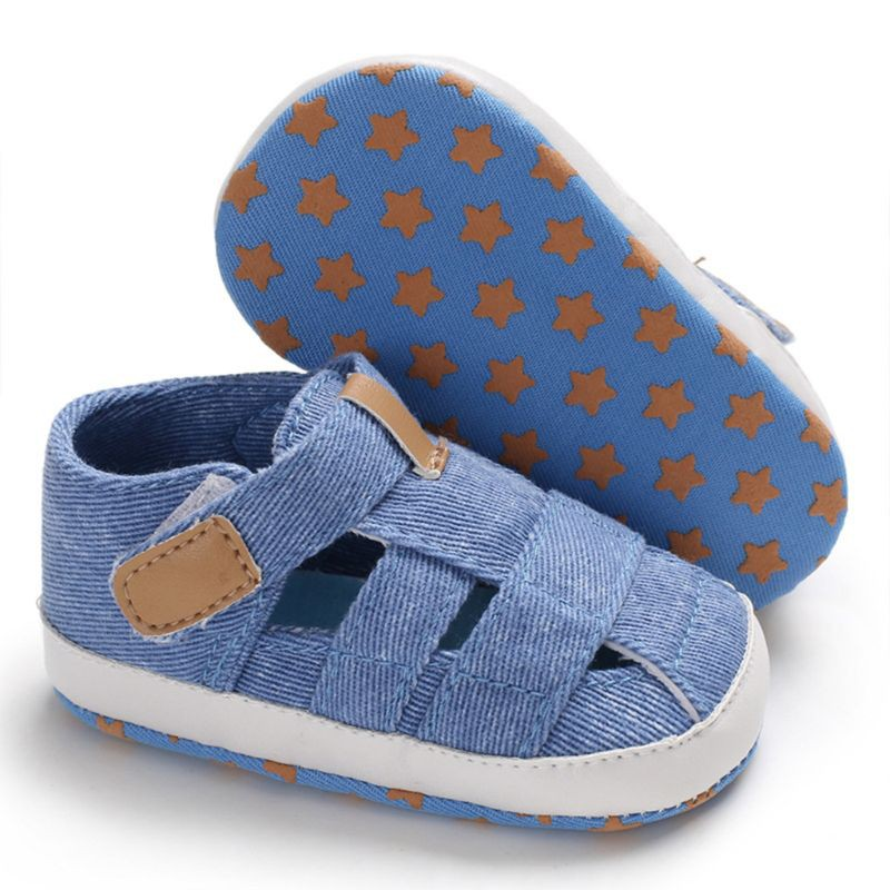 Baby boy Pre-Walker soft sole closed toe sandal with BOAT embroidery on foot.