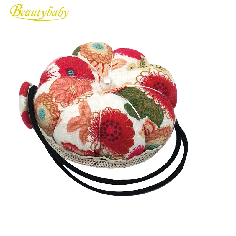 diameter 6 cm . 2 x pumpkin pin cushion in green and pink with elastic rubber for the wrist