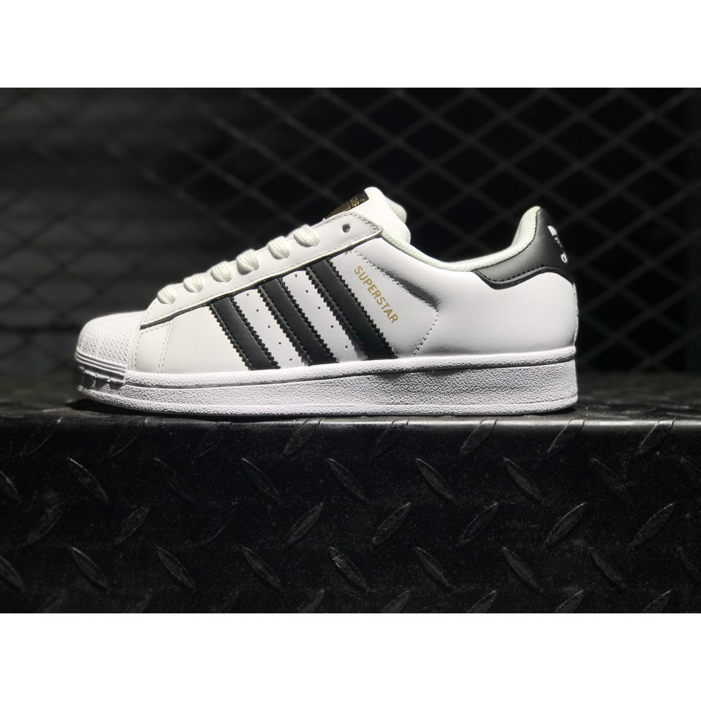 adidas superstar black and white junior