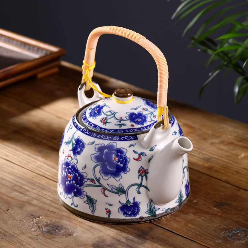 Blue and white Asian teapot with teacup
