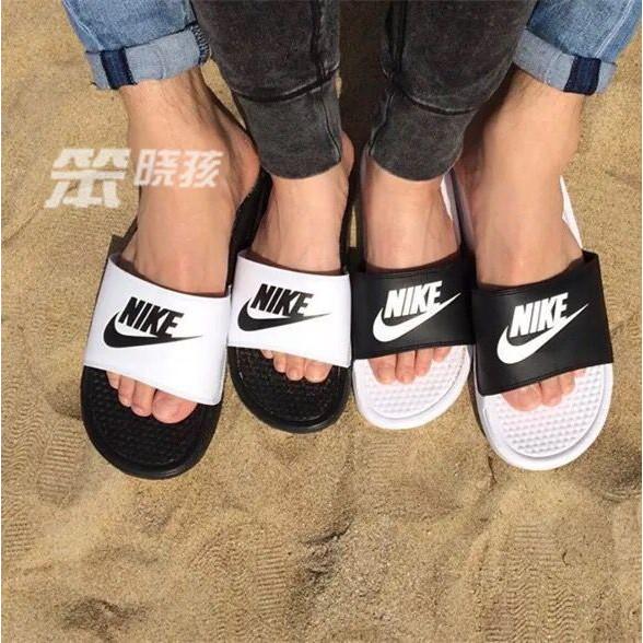 cheap for discount 5c537 9d27e Original Nike Benassi couple sports slippers 818736-001